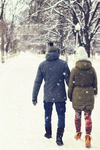 Couple walking through snow